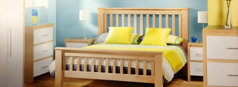 Wooden bed with yellow bedding
